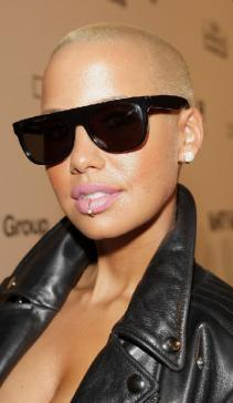 Amber Rose attends amfAR Milano 2009 Red Carpet, the Inaugural Milan Fashion Week event at La Permanente on September 28, 2009 in Milan, Italy.